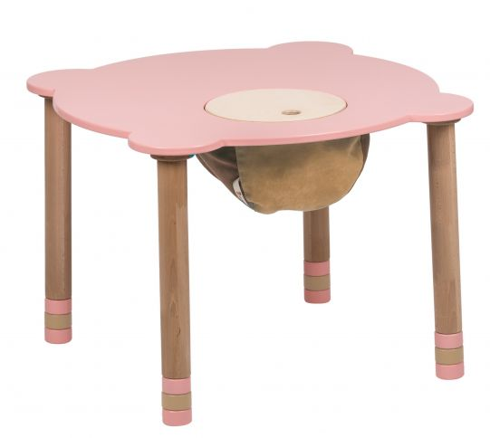 Pyöreä vaaleanpunainen pöytä